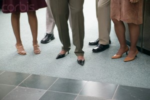 View of a group of people's feet standing in an office